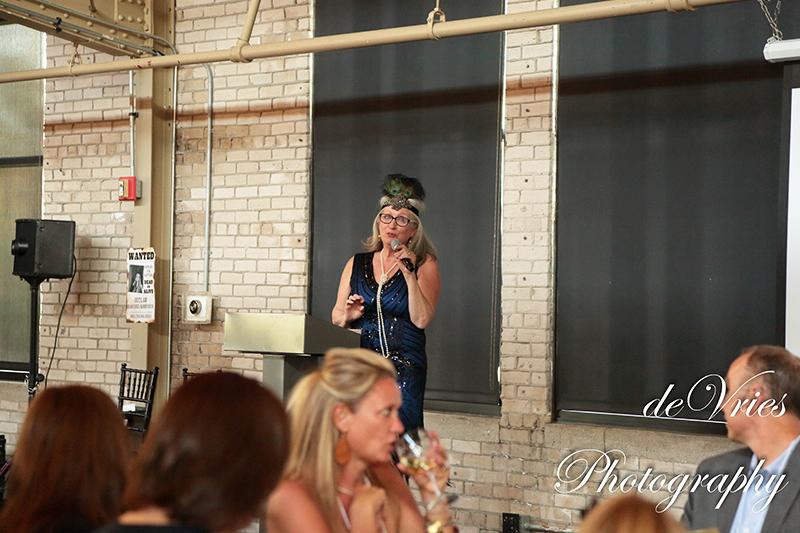lady speaking at celebration gala