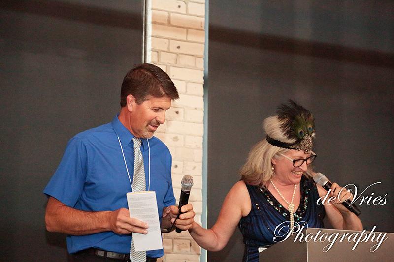 people speaking at celebration gala