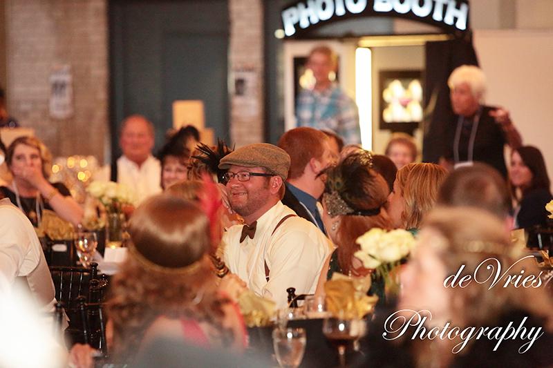 people sitting around tables at celebration gala