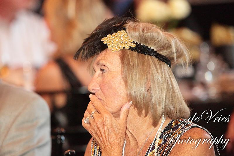 lady watching something at the celebration gala